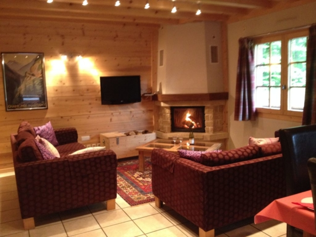 Living room with sofas and log fire
