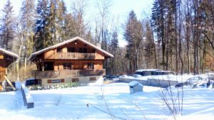 Chalet Milou front with blue sky and snow
